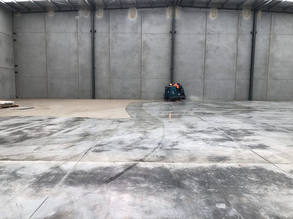 warehouse floor cleaning by using a machine